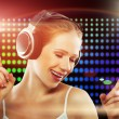Portrait of a young dancing girl in headphones — Stock Photo #12018130
