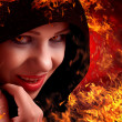 Stock Photo: Woman witch on fire, Halloween