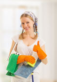 Happy housewife shows a thumb up — Stock Photo