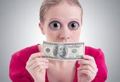 Money concept. woman with a big eyes and mouth closed dollar — Stock Photo