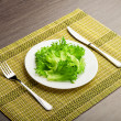 Royalty-Free Stock Photo: Diet concept. green lettuce on a plate with a fork and knife