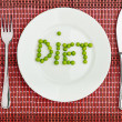 "Concept: healthy  food  and diet. the word ""diet"" green peas on — Stock Photo"