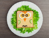 Design food. Creative sandwich for child with picture little ow — Stock Photo