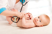Pediatrician doctor and patient - small child — Stock Photo