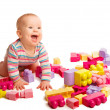 Baby playing in designer toy blocks — Stock Photo #20799747