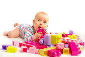 Baby playing in designer toy blocks — Stock Photo