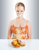 Diet concept. woman mouth sealed with duct tape with buns — Stock Photo