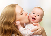 Happy cheerful family. Mother and baby kissing — Stock Photo
