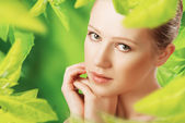 Beauty woman and a natural skin care in green — Stock Photo