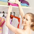 Woman chooses clothes in the wardrobe closet at home — Stock Photo #25161625