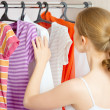 Woman chooses clothes in the wardrobe closet at home — Stock Photo