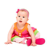 Surprised, sad little baby girl in bright multicolored festive d — Stock Photo