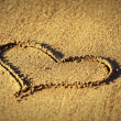 Concept of love.  heart in the sand — Stock fotografie