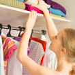 Woman chooses clothes in the wardrobe closet at home — Stock Photo #30322925