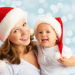 Happy family mother and baby in Christmas hats — Foto de Stock