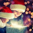 Christmas magic gift box and a happy family mother and baby — Foto de Stock