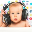 Happy baby with headphones listening to music — Stock Photo