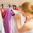 Woman chooses clothes in the wardrobe closet at home — Stock Photo #31266123