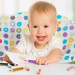 Happy baby child draws with colored pencils crayons — Stock Photo