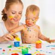 Stock Photo: Mother and baby paint colors hands dirty
