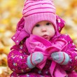 Funny happy baby girl child outdoors in the park in autumn — Stock Photo