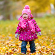 Happy baby girl child outdoors in the park in autumn — Stock Photo #32834583