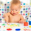 happy child draws with colored paints hands — Stock Photo