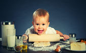 Little baby girl is cooking, baking — Stock Photo