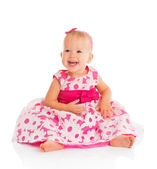 Happy little baby girl in bright pink festive dress isolated — Stock Photo