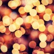 Stock Photo: Red golden Christmas lights background with bokeh