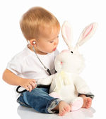 Baby plays in doctor toy bunny rabbit and stethoscope — Stock Photo