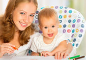 Mother and baby draw color pencil — Stock Photo