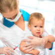 Doctor does injection child vaccination baby — Stock Photo #34594169
