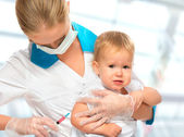 Doctor does injection child vaccination baby — Stock Photo