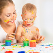 Mother and baby paint colors hands dirty — Stock Photo
