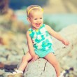 Cheerful happy baby girl laughing on  walk in nature — Stock Photo