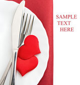 Plate, fork, knife and red hearts — Stock fotografie