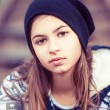 Beauty teenage girl in hat outdoors — Stock Photo