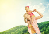 happy family. mother and daughter baby girl playing on nature — Stock Photo
