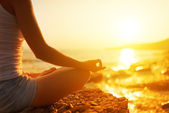 Hand of woman meditating in a yoga pose on beach — Foto de Stock