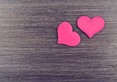 Two red hearts on a wooden board — Stock Photo