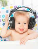 Happy baby with headphones — Stock Photo