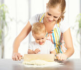 Baby girl with her mother cook, bake — Stock Photo