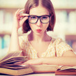 Funny girl student with glasses reading books — Foto de Stock   #41477171