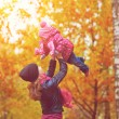Нарру family. Mom and baby daughter for walk in autumn — Stock Photo #45406041