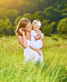 Happy family on nature mother and baby daughter  — Stock Photo
