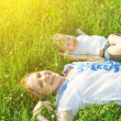 Happy family on nature. mom and baby daughter are playing in the — Stock Photo