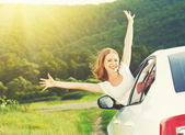Happy woman looks out the car window on nature — Stock Photo