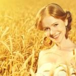 Beautiful happy girl in wheat field in summer — Stock Photo #50719667