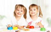 Happy children twins draws paints , get dirty — Stock Photo
